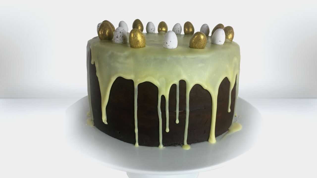 ganache and ganache drip for a cake - meadow brown bakery